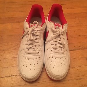 White and red Air Force 1's